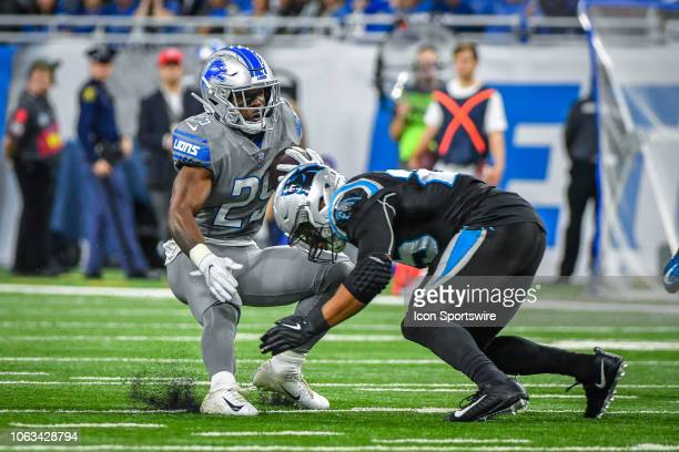 Detroit Lions running back Theo Riddick runs into Carolina Panthers strong safety Eric Reid after a long gain during the Detroit Lions versus...