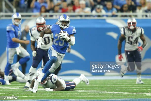Detroit Lions running back Theo Riddick runs with the ball during a regular season game between the New England Patriots and the Detroit Lions on...