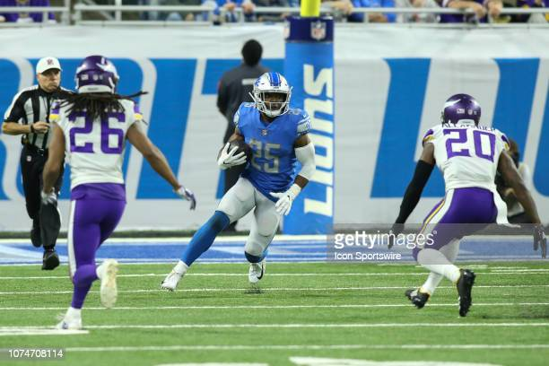 Detroit Lions running back Theo Riddick runs with the ball during a regular season game between the Minnesota Vikings and the Detroit Lions on...
