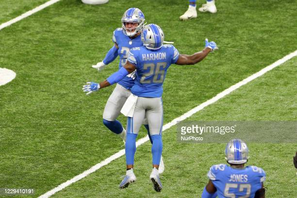 Detroit Lions safety Miles Killebrew and Detroit Lions strong safety Duron Harmon celebrate after a play during the first half of an NFL football...