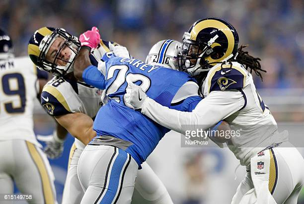 Detroit Lions strong safety Don Carey battles with Los Angeles Rams defensive back Cody Davis , left, and defensive back Marqui Christian during the...