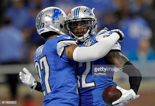 Detroit Lions strong safety Tavon Wilson is congratulated after recovering a fumble by Detroit Lions free safety Glover Quin during the first half of...
