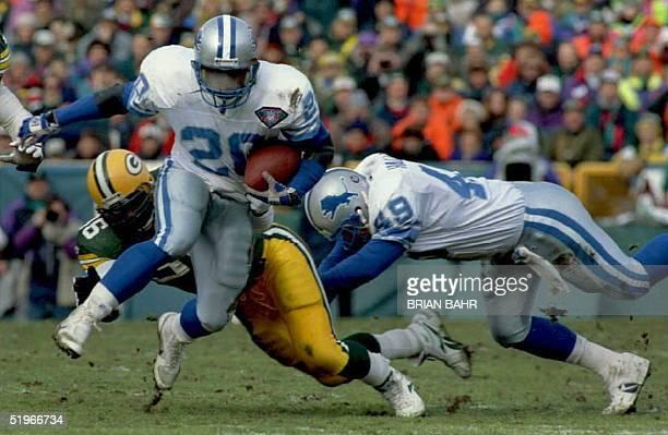 Detroit Lions superstar Barry Sanders eludes Green Bay Packer defensive end Sean Jones in the first quarter at Lambeau Field in Green Bay 31 December...