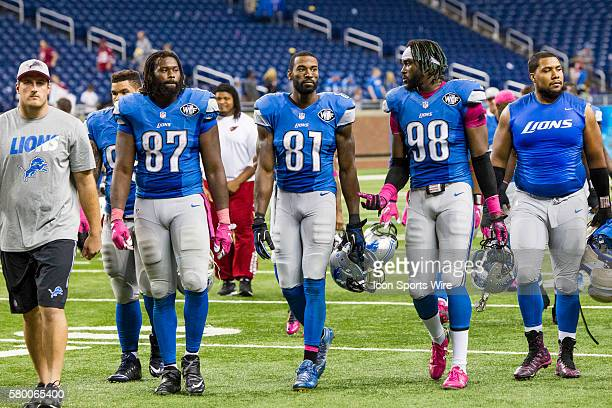 Detroit Lions tight end Brandon Pettigrew Detroit Lions wide receiver Calvin Johnson and Detroit Lions defensive end Devin Taylor walk off of the...