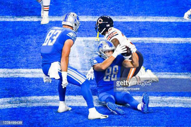 Detroit Lions tight end T.J. Hockenson holds the ball up to show the referee that he made the catch for a touchdown during the Detroit Lions versus...