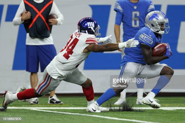 Detroit Lions wide receiver Brandon Powell runs the ball under the pressure New York Giants running back Jalen Simmons during the second half of an...