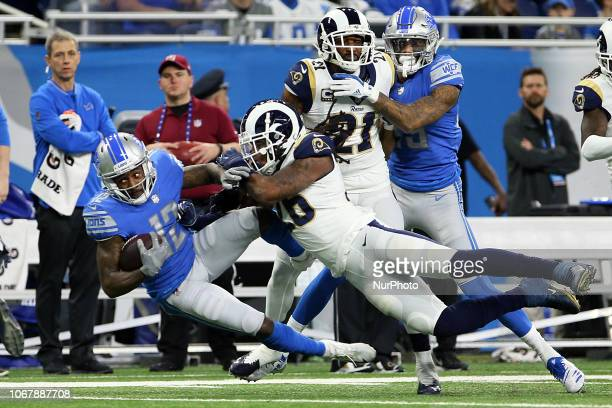 Detroit Lions wide receiver Bruce Ellington is sacked by Los Angeles Rams inside linebacker Mark Barron during the first half of an NFL football game...