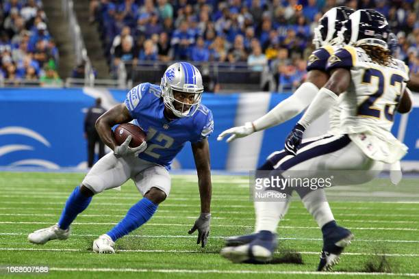 Detroit Lions wide receiver Bruce Ellington runs for yardage under the pressure of Los Angeles Rams defensive back Nickell RobeyColeman and Los...