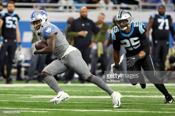 Detroit Lions wide receiver Bruce Ellington runs the ball under the pressure of Carolina Panthers strong safety Eric Reid during the second half of...