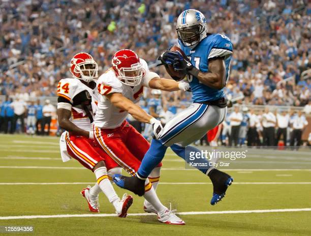 Detroit Lions wide receiver Calvin Johnson hauls in a firstquarter touchdown past the defense of Kansas City Chiefs safety Jon McGraw and Brandon...