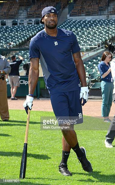 Detroit Lions wide receiver Calvin Johnson looks on while taking batting practice before the game between the Detroit Tigers and the Pittsburgh...