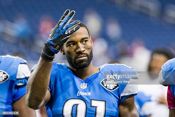 Detroit Lions wide receiver Calvin Johnson waves to fans as he walks off of the field at the end of the game between the Arizona Cardinals and the...