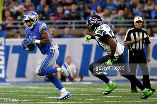 Detroit Lions wide receiver Golden Tate runs the ball under the pressure of Seattle Seahawks linebacker KJ Wright during the first half of an NFL...