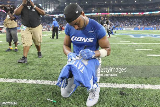 Detroit Lions wide receiver Golden Tate signs his jersey at the conclusion of the game between the Atlanta Falcons and the Detroit Lions on September...