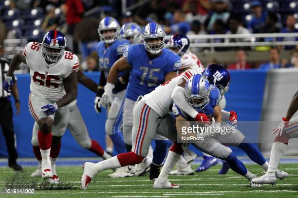 Detroit Lions wide receiver Jace Billingsley is tackled by New York Giants wide receiver Hunter Sharp during the second half of an NFL football game...