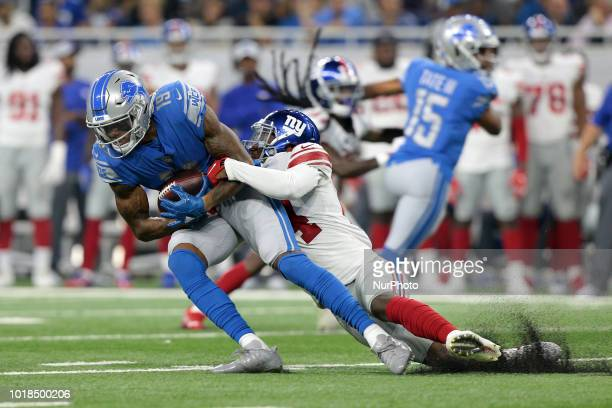 Detroit Lions wide receiver Kenny Golladay is tackled by New York Giants cornerback Eli Apple during the first half of an NFL football game in...