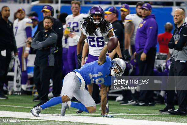 Detroit Lions wide receiver Kenny Golladay shows the official that he maintained control of the ball after catching a pass during game action between...