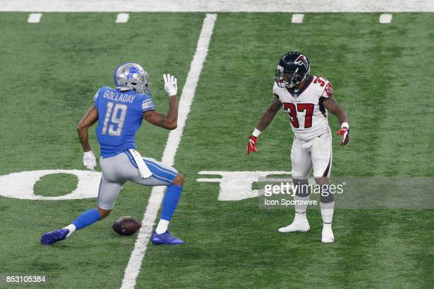Detroit Lions wide receiver Kenny Golladay signals that he has made a first down after catching a pass and running with the ball during game action...