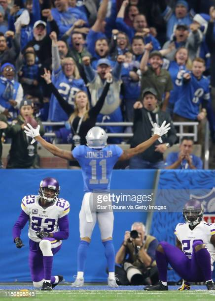 Detroit Lions wide receiver Marvin Jones celebrated his 43 yard 4th quarter touchdown over Minnesota Vikings cornerback Terence Newman and Xaavier...