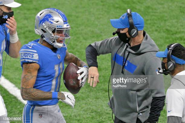Detroit Lions wide receiver Marvin Jones is congratulated by interim head coach Darrell Bevell after scoring a touchdown during the first half of an...