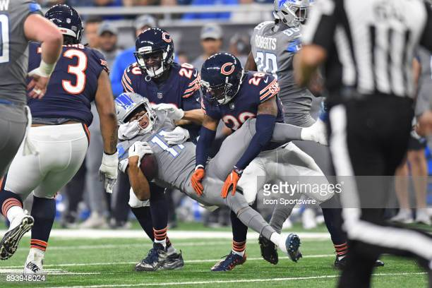 Detroit Lions wide receiver Marvin Jones Jr is tackled by Chicago Bears defensive back Prince Amukamara and defensive back Deon Bush during a game...