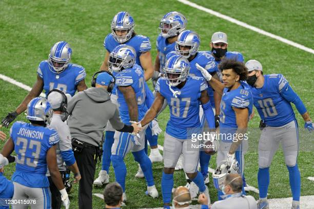 Detroit Lions wide receiver Quintez Cephus is congratulated by interim head coach Darrell Bevell and teammates after scoring a touchdown during the...