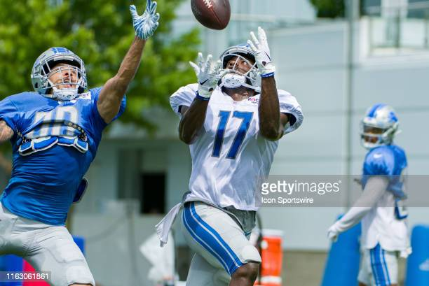 Detroit Lions WR Andy Jones catches a pass over the hand of Detroit Lions CB Dee Virgin during NFL football practice on August 20 2019 at Detroit...