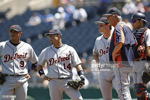 Detroit manager Jim Leyland and various players await a reliever during action between the Detroit Tigers and Kansas City Royals at Kauffman Stadium...