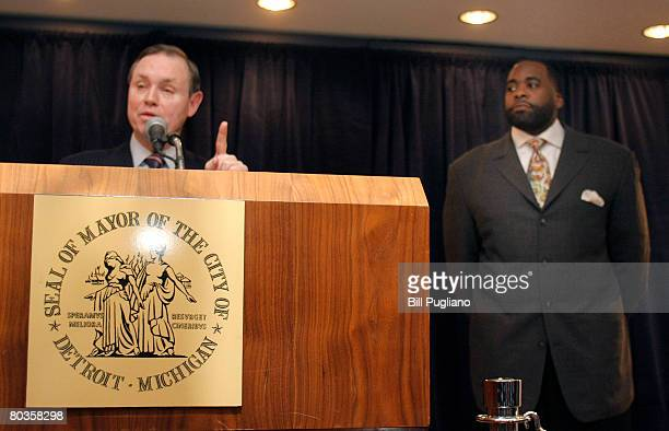 Detroit Mayor Kwame Kilpatrick listens to his attorney Daniel Webb speak at a news conference before responding himelf to the news that he and his...