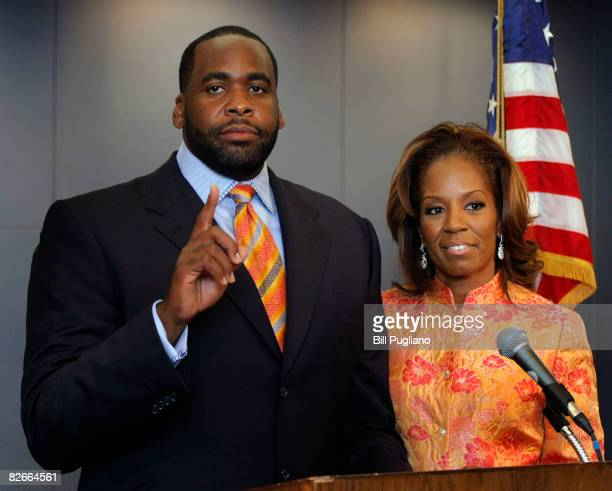 Detroit Mayor Kwame Kilpatrick stands with his wife Carlita after reading a statement September 4 2008 at his office in Detroit Michigan Kilpatrick...