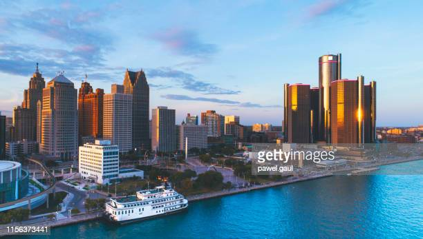 detroit michigan downtown skyline aerial sunset - detroit river stock pictures, royalty-free photos & images