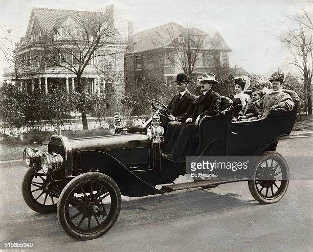 Detroit, Michigan: Ford family and friends out for a drive on Detroit street in the 1906 Model K-6 cylinder auto. Left to right: Henry Ford, Leroy...