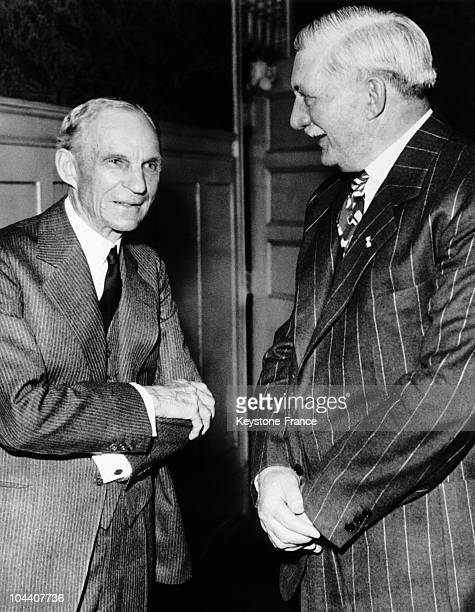 Detroit, Michigan. Henry FORD, founder of the Ford Motor Company and William S. KNUDSEN, president of the company, during a dinner honoring KNUDSEN...