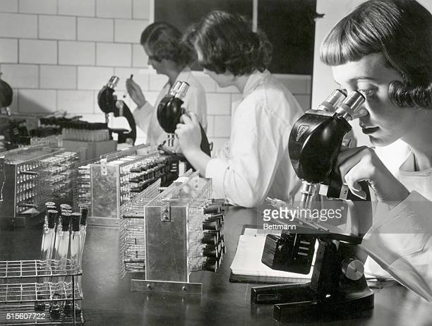 Detroit, Michigan- In one of the crucial safety tests, special microscopes are used during the processing of National Foundation Poliomyelitis...