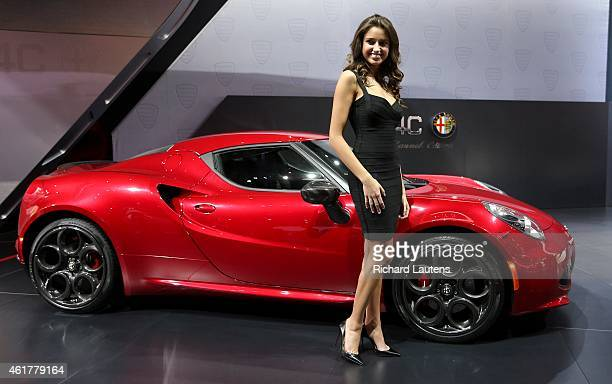 Detroit, Michigan - January 12 - A model poses by the new Alpha Romeo 4C Spider. The North American International Auto Show opened to the media at...