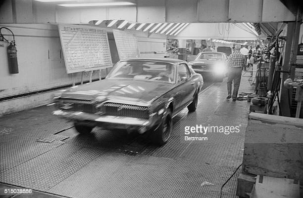 New Mustangs and Mercury Cougars move off the final assembly line at Ford Motor Co's Dearborn assembly plant after automotive production resumed...