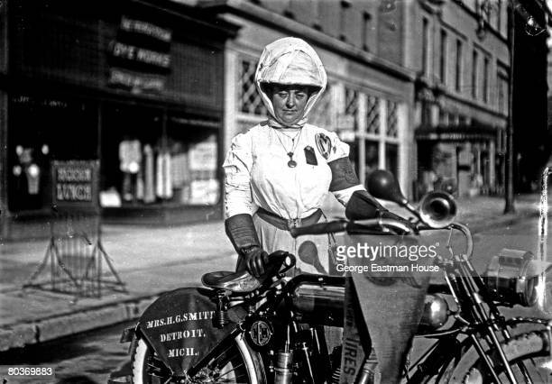Detroit Michigan resident Mrs HG Smith poses with her Marvel Motorcycle Company cycle early 1910s She wears a hat tied under her chin blouse and...