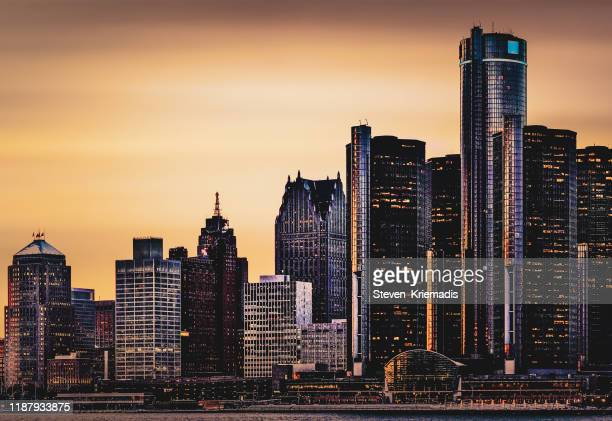 detroit, michigan - skyline at dusk - michigan stock pictures, royalty-free photos & images