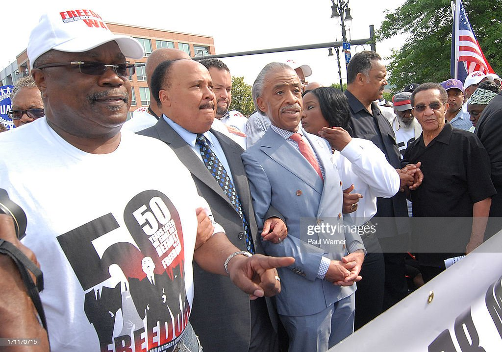 Detroit NAACP President Wendell Anthony, Reverend Martin Luther King Jr's son Martin Luther King III, Reverend Al Sharpton, Reverend Jesse Jackson and march grand marshal Tony Brown march during the 50th Anniversary Freedom March on June 22, 2013 in Detroit, Michigan.