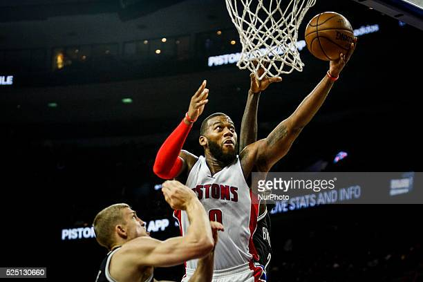 Detroit Pistons' Andre Drummond makes a layup under the basket during the second half of the home opener against Brooklyn Nets Saturday November 1 at...