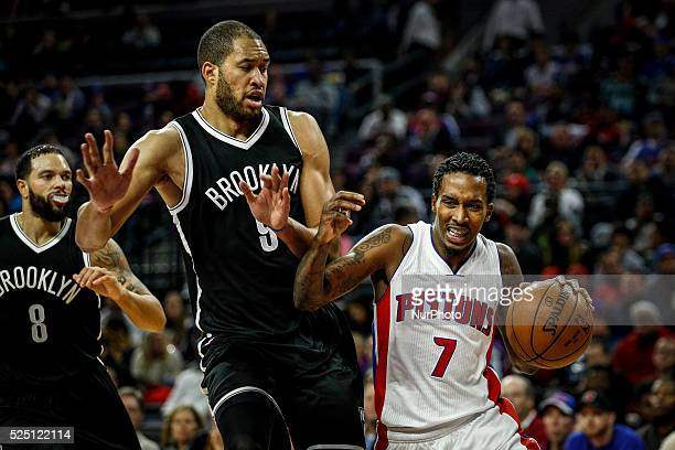 Detroit Pistons' Brandon Jennings , center, struggles in front of Brooklyn Nets' Jerome Jordan during the second half of the home opener, Saturday,...