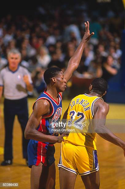 Detroit Pistons' Dennis Rodman guards against the Los Angeles Lakers' Magic Johnson during the 1988 NBA Playoffs at the Great Western Forum in...