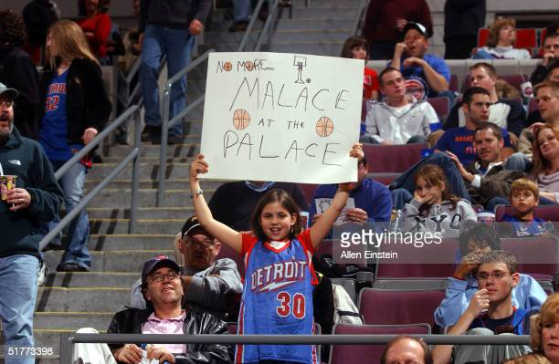 Detroit Pistons fan holds up a sign referring to the Pistons Pacers fight as the Detroit Pistons played the Charlotte Bobcats on November 21 2004 at...