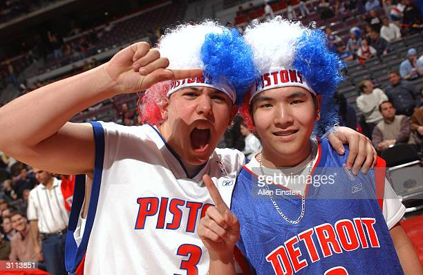 Detroit Pistons fans wear Ben Wallace afro wigs in NBA action against the Denver Nuggets March 19 2004 at the Palace of Auburn Hills in Auburn Hills...
