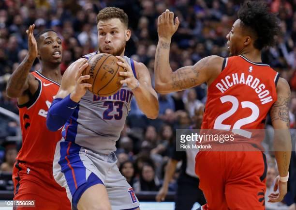 Detroit Pistons forward Blake Griffin splits the defence of Toronto Raptors guard Delon Wright and Toronto Raptors guard Malachi Richardson Toronto...