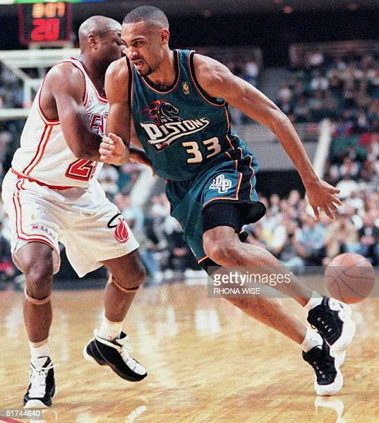 Detroit Pistons' forward Grant Hill races to the basket without the ball after it was knocked away by Miami Heat guard Voshon Lenard in second period...