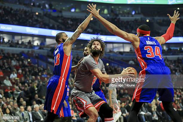 Detroit Pistons forward Marcus Morris and forward Tobias Harris guard Chicago Bulls center Robin Lopez during the first half on Monday Dec 19 2016 at...