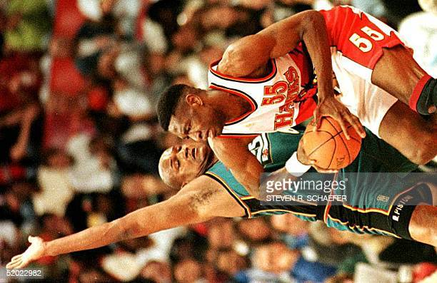 Detroit Pistons Forward Terry Mills pressures Dikembe Mutombo a center for the Atlanta Hawks during their second first round playoff game at the Omni...