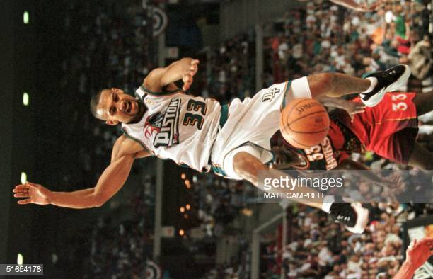 Detroit Pistons' Grant Hill loses the ball in front of the Atlanta Hawks Tyron Corbin in the fourth quarter of their NBA Eastern Conference playoff...