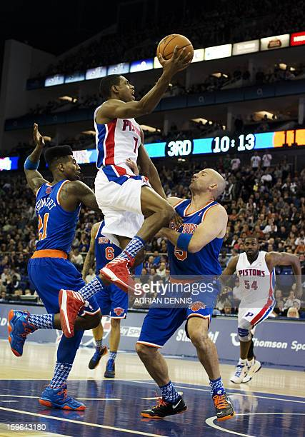 Detroit Pistons' guard Brandon Knight goes to the basket against New York Knicks' guards Jason Kidd and Iman Shumpert during their NBA basketball...